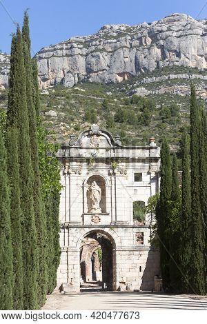 Tarragona, Spain, May 1, 2020 - Facade Ruins Of Monastery Cartoixa Escaladei In Catalonia On Backgro