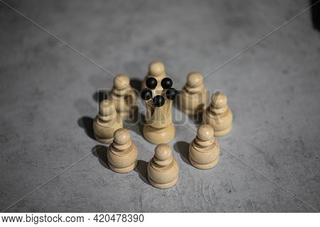 White Queen Wooden Chess Piece Surrounded By White Pawns Standing On Gray Table Copy Space. Queen Wi