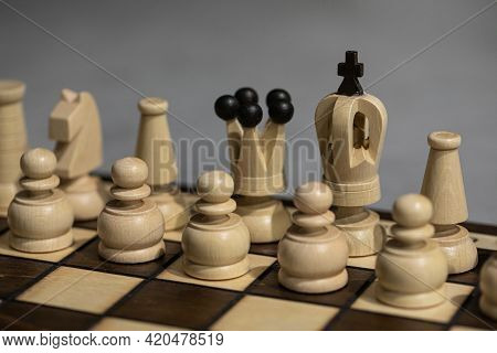 White Chess Pieces On Board, Arranged In Incorrect Initial Position. King Is Not In His Chessboard S