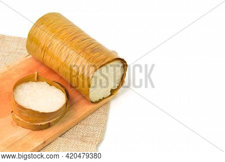 Malaysian Traditional Food Called As Lemang On Wooden Board. Glutinous Rice Is Wrapped With Banana L
