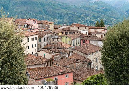 Old Tiled Roof. Beautiful Roofs In The Medieval Town Of Barga In Tuscany In The Mountains Of Italy.