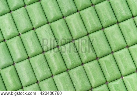 Green Mint Chewing Gum Tablets Aligned. Top View. Close-up.