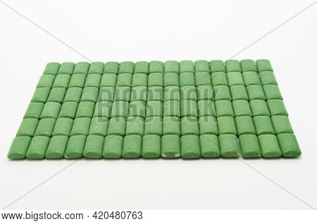 Green Mint Chewing Gum Tablets Aligned. Isolated On White Background.