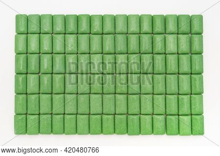 Green Mint Chewing Gum Tablets Aligned. Isolated On White Background. Top View.