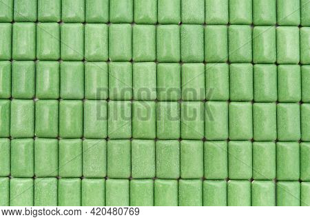 Green Mint Chewing Gum Tablets Aligned. Top View. Close-up. Horizontal Shot.