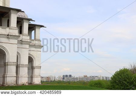 Colonnade Of The Church Of The Ascension Against The Background Of Urban Residential Buildings, Mosc