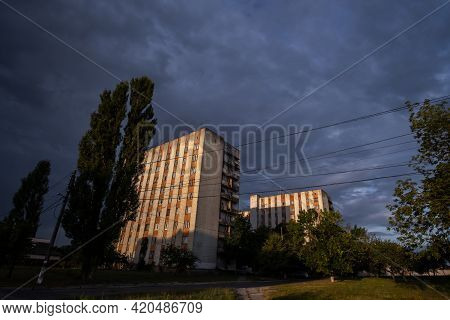 Orange Sun Light On An Old Soviet Buildings Town In Zhytomyr City In Ukraine. Soviet Union Architect