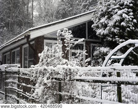 Blizzard And A House In Countryside Covered With Snow, Winter Scene