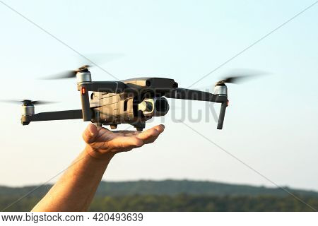 The Drone Lands On The Outstretched Arm. Selective Focus. Copy Space.