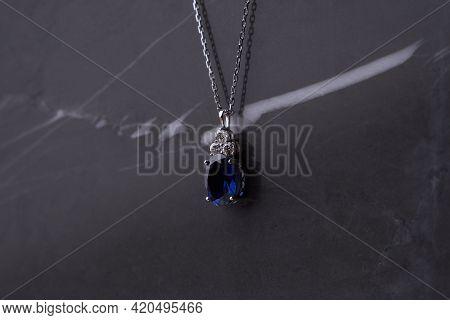 Sapphire Pendant With Platinum Necklace.