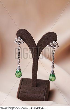 Diamond Earrings With Large Emerald