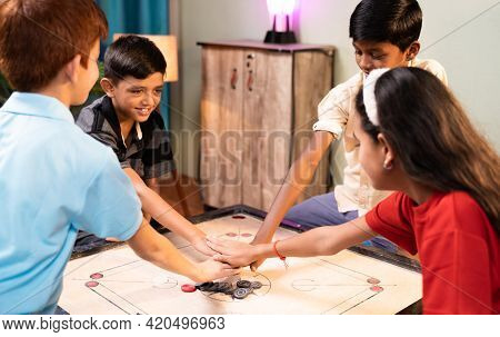 Focus On Carrom Coins, Group Of Kids To Decide For Pair To Play Carrom By Clapping Or Flipping Hands