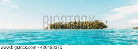 Beach paradise travel vacation view of tropical motu island idyllic crystalline turquoise ocean in Rangiroa atoll, Tuamotu islands, French Polynesia. Tahiti honeymoon destination panoramic banner.