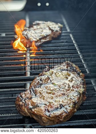 Usda Premium Ribeye Steaks On A Grill