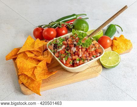 Mexican Appetizer Pico De Gallo In A Bowl And Ingredients On The Table. Homemade Salsa Sauce, Great