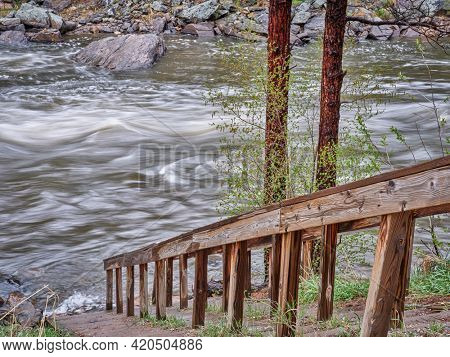 river access for whitewater paddlers - Poudre River in the canyon above Fort Collins, Colorado, spring scenery with high water flow