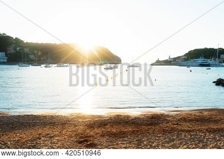 Sunset In Port Soller Harbour With Ships, Mallorca At Summer