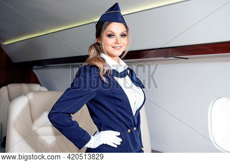 Uniformed Flight Attendant Greets On Board The Plane, A Beautiful Young Woman,