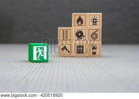 Fire Exit, Cube Wooden Toy Block Stack With Door Exit Sing Or Fire Escape Icon With Fire Extinguishe