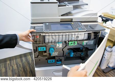 Copier Printer, Close Up Hand Of Technician To Open Cover Photocopier Machine To Fix The Problem And