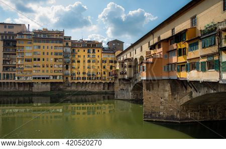 Ponte Vecchio Landmark Reflected On Arno River. Florence, Tuscany Italy.
