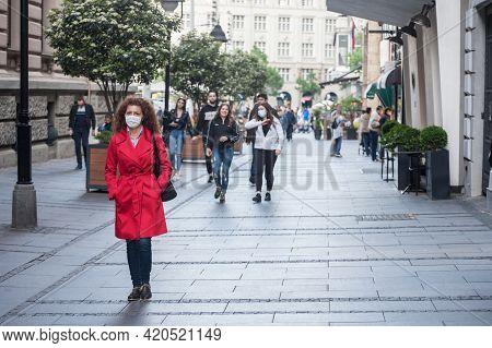 Belgrade, Serbia - May 8, 2021: Woman, A Young Girl, Walking Alone Wearing Face Mask Respiration Pro