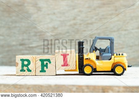 Toy Forklift Hold Letter Block I To Complete Word  Rfi (abbreviation Of Request For Information) On