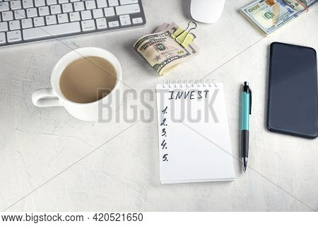 Invest Written In Notebook, Wad Of Dollars Money Cash In Elastic Band Copy Space Background,concept
