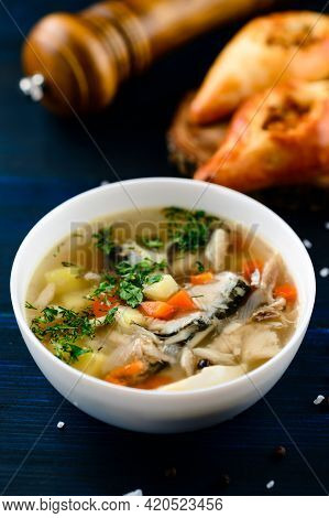 Hot Tasty Healthy Soup With Fish And Vegetables Served On A Round Plate On Wooden Table