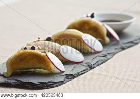 Four Gyoza Dim Sum Dumplings With Soya Sauce