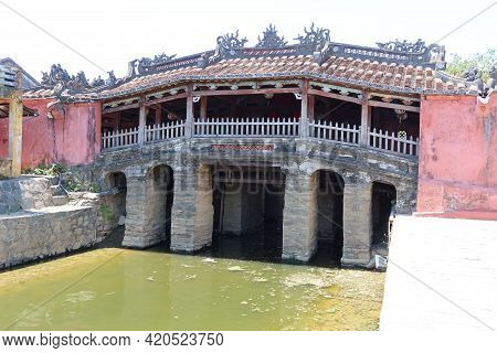 Hoi An, Vietnam, May 15, 2021: Side View Of The Japanese Bridge In Hoi An, Vietnam. One Of The Most