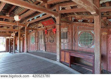 Hoi An, Vietnam, May 15, 2021: Wooden Interior Passage Of The Japanese Bridge In Hoi An, Vietnam. On
