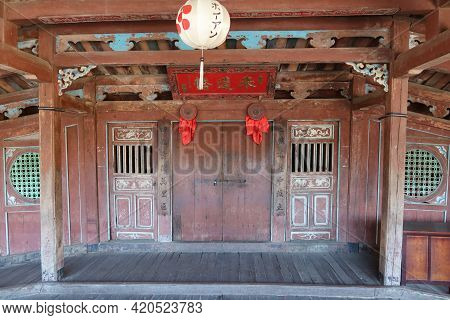 Hoi An, Vietnam, May 15, 2021: Entrance Gate To The Temple In The Inner Passage Of The Japanese Brid
