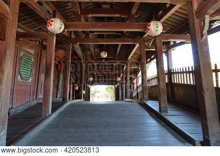 Hoi An, Vietnam, May 15, 2021: Wooden Interior Passage Seen From The North Entrance Of The Japanese