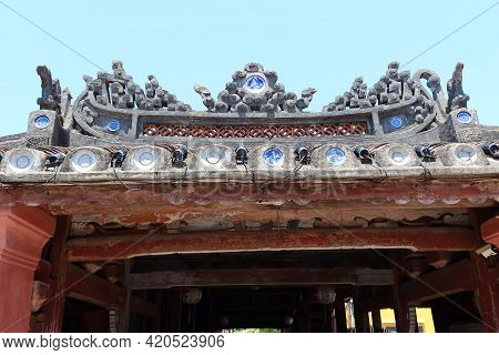 Hoi An, Vietnam, May 15, 2021: Decoration Of The Roof Of The North Entrance Of The Japanese Bridge I