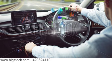 Composition of data processing on interactive screen over businessman driving car. business, technology and digital interface concept digitally generated image.