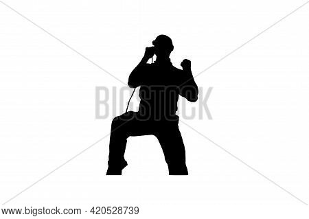 Silhouette Of A Male Rock Singer With A Microphone On A White Background. A Man Emotionally Performi