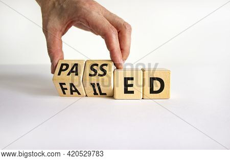 Passed Or Failed Symbol. Businessman Turns Wooden Cubes And Changes The Word 'failed' To 'passed' On