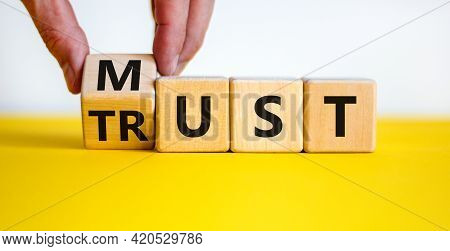 Must Trust Symbol. Businessman Turns Wooden Cubes With Words 'must Trust'. Beautiful Yellow Table, W