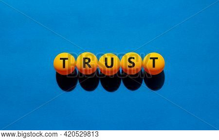 Trust Symbol. Orange Table Tennis Balls With The Words 'trust'. Beautiful Blue Background, Copy Spac