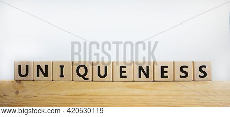 Inclusiveness And Uniqueness Symbol. Wooden Cubes With The Word 'uniqueness' On Wooden Block. Beauti