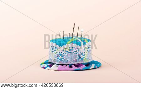 Needle Pillow With Metal Needles And Pins. Copy Space.
