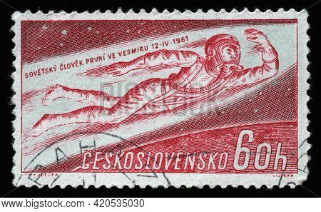 ZAGREB, CROATIA - SEPTEMBER 18, 2014: Stamp printed in Czechoslovakia shows Man Flying into Space, Yuri A. Gagarin, first man in space series, circa 1961