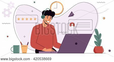 Сustomer Service Agent Sits In Front Of A Computer Wearing Headphones And Communicates With A Client