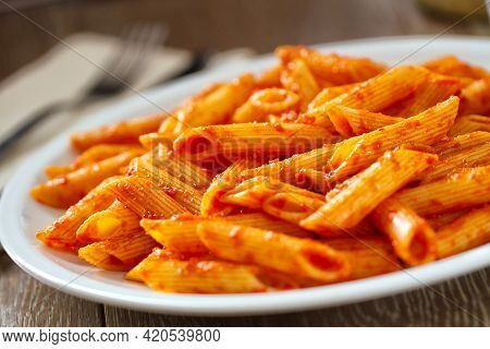 Pasta With Tomato Sauce On A Plate. High Quality Photo.