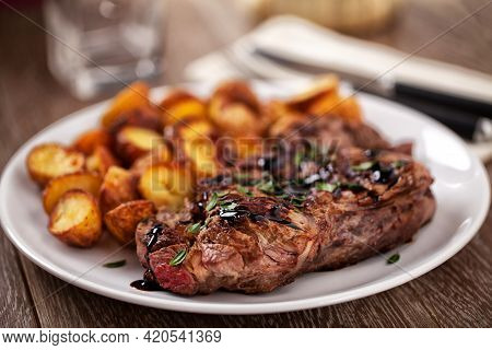 Grilled Beefsteak With Baby Roasted Potatoes. High Quality Photo.