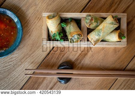 Vietnamese Spring Rolls With Sweet Sauce. Fried Chinese Spring Rolls With Sweet Chili Sauce. Asian A