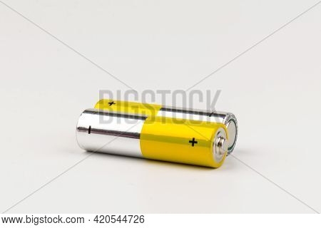 Composition With Alkaline Batteries On White Background. Chemical Waste
