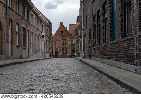 A Low Angle View Of Typical Brick Buildings In The Historic City Center Of Bruges