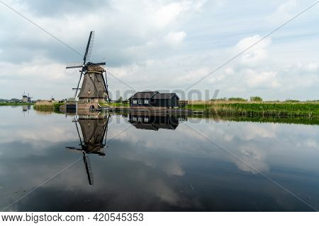 A View Of A Historic 18-century Windmill At Kinderdijk In South Holland